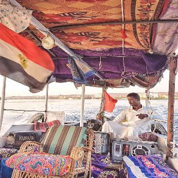 Cruising the Nile River on a motor boat in Aswan Interesting to notice that this boat decoration al