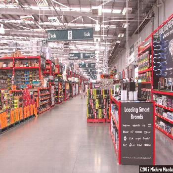Inside a DIY tool shop Bunnings interior with rows of neatly placed products under large print of h