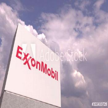 Logo of EXXON MOBIL on a stand against cloudy sky, editorial 3D rendering ,