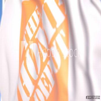 Waving flag with The Home Depot, Inc. logo, close-up. Editorial 3D rendering ,