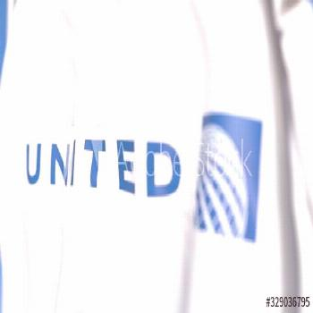 Waving flag with United Airlines logo, close-up. Editorial 3D rendering ,