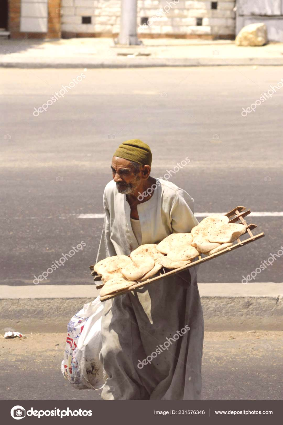 Download - CAIRO, EGYPT - AUGUST 3 The poor old man sells wheat flat cakes near...#august