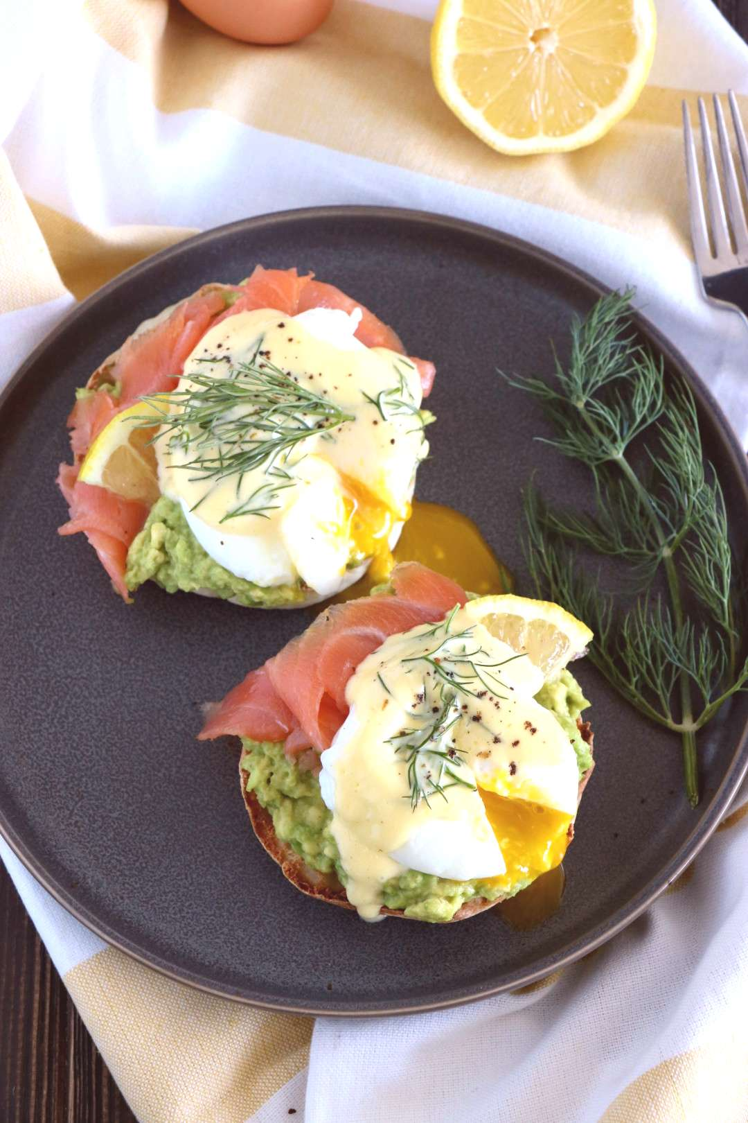 Fancy eggs Benedict with mashed avocado, smoked salmon, and a subtle homemade Hollandaise with fres