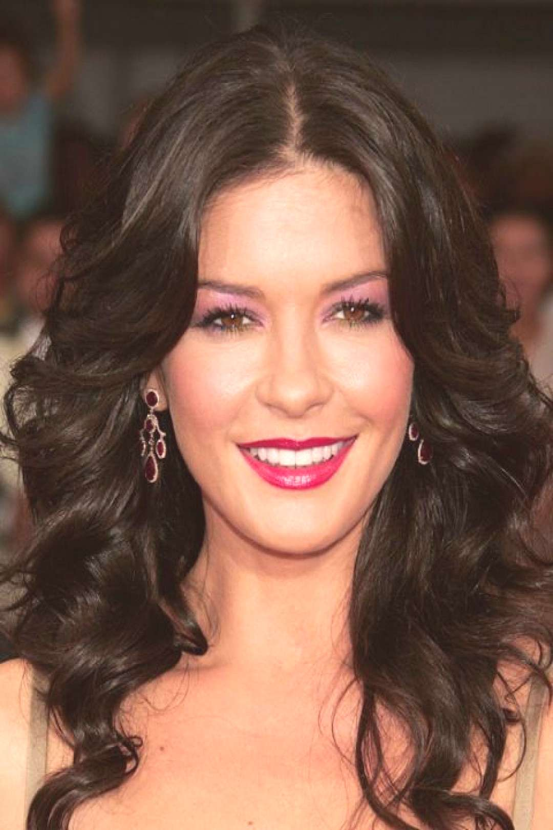 The 50 Most Iconic Beauty Looks of All Time -  THE LOOK: PURPLE EYESHADOW – Catherine Zeta-Jones,
