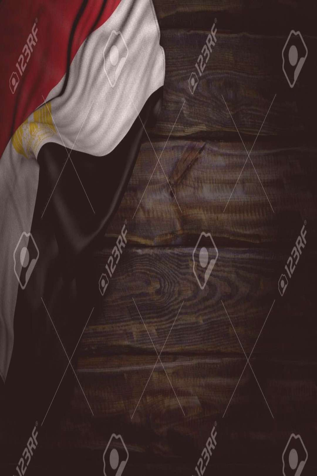 wonderful dark picture of Egypt flag with big folds on old wood with empty space for text - any cel